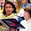 JIM VAIKNORAS/Staff photo Allison Balentine works with Ava Shimer, 11, at a rehearsal for the Greater Newburyport Children's Choir at the Hope Church in Newburyport.
