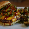 JIM VAIKNORAS/Staff photo Cowboy burger at Lexies on State , chedder cheese, avacado, crispy onions, BBBQ, and chimmichurri.$6.25
