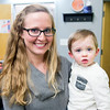 JIM VAIKNORAS/Staff photo Ashley Marino hold her 18 month old son Easton at Fitness Together's Have a Heart Fundraising Event to benefit Sweet Paws Rescue.