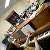 JIM VAIKNORAS/Staff photo Allison Balentine on piano and Gina McKeown conducting a rehearsal for the Greater Newburyport Children's Choir at the Hope Church in Newburyport.
