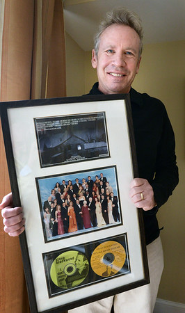 BRYAN EATON/Staff photo. Blackwood with memorabilia including a photo of the cast of Days of Our Lives, movie poster from EdGein:The Movie and two albums one of which was produced by Pat Boone.