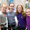 JIM VAIKNORAS/Staff photo Olivia Hansen, 12, Hannah Gross, 12, Sophia Hartford, 12, and Shaelin Lombardi,11, at the Girls Rock Climb-A-Thon to benefit Girls Inc. of the Seacoast Area, a program of the Jeanne Geiger Crisis Center at Metro Rock Climbing in Newburyport.