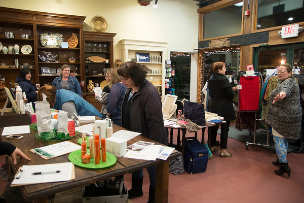 JIM VAIKNORAS/Staff photo Mom's and guests shop  at Moms' Night Out with Macaroni Kid at Port Plum in Newburyport.