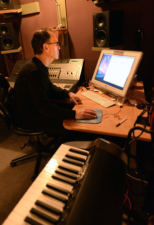 BRYAN EATON/Staff photo. Mixing music is his studio.