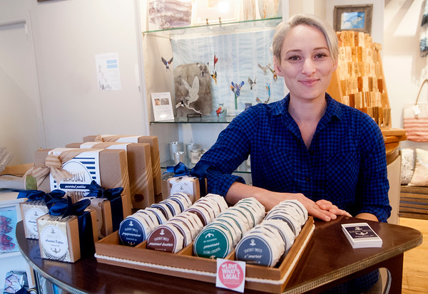 JIM VAIKNORAS/Staff photo Kirstyn Pearl owner of Seacoast Sweets gives out her locally made treats at Port Blue during the Sweet Taste of Newburyport.
