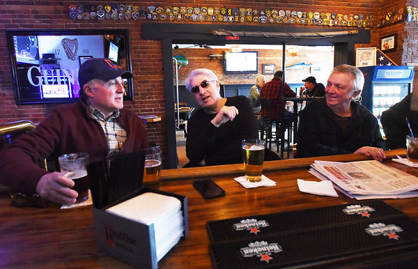"BRYAN EATON/Staff photo. Thirsty Whale regulars chat at the bar, from left, Phil Gardella, Bob ""Bahama Bob"" Urzi and Brian Michaels on a recent afternoon."