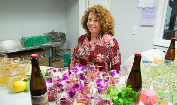 JIM VAIKNORAS/Staff photo Bartender Erica Yeomans serves drinks at the House Bear Brewing grand opening celebration.