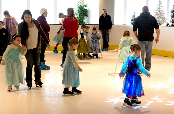 JIM VAIKNORAS/Staff photo Princesses and their moms and dads skate at the Frozen Brunch and Skate Party at Seaglass in Salisbury.