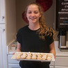 JIM VAIKNORAS/Staff photo Molly Laliberty holds a tray of Almond Chocolate cookies at The Buttermilk Baking Company on Liberty Street in Newburyport. The store was one of many giving out treats as part the Sweet Taste of Newburyport.
