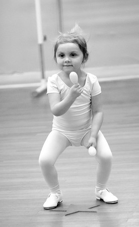 JIM VAIKNORAS/Staff photo Aubrey Salter of Newburyport used maracas as she tap dances at Broadway Academy.