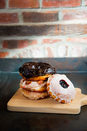 JIM VAIKNORAS/Staff photo A Pizza donut, A Maple Bacon donut, a Chocolate Sea Salt Caramel donut , and a Jilly's Jelly's Donut from Angry Donut at Silvaticus in Amesbury.