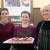 JIM VAIKNORAS/Staff photo Employees Maddie Cutrone, of Newburyport, Kathryn Tolley of Amesbury, and Hallimeda Allinson of Amesbury hold a tray of treats at The Chococoa Baking Company during the Sweet Taste of Newburyport.