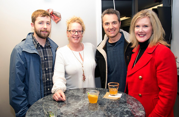 JIM VAIKNORAS/Staff photo Kyle Cutciliffe , of West Newbury, Kim Furnari, of Newbury, and Dominic and Jean Poliseno of West Newbury at the House Bear Brewing's grand opening celebration