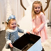 JIM VAIKNORAS/Staff photo Charlie Bates, 2, and her cousin Emme Coddaire, 5, get ready to throw snowballs at Olaf at the Frozen Brunch and Skate  Party at Seaglass in Salisbury.