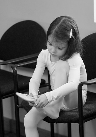 JIM VAIKNORAS/Staff photo Anais Byron of Newburyport puts on her ballet slippers before class.