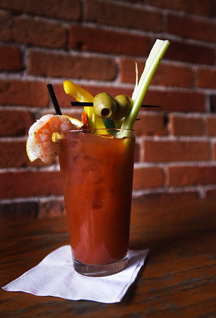 BRYAN EATON/Staff photo. The Thirsty Whale's famous Bloody Mary is served anytime, but come with garnishes that could make a meal on Sundays. They also sell out of them on Thanksgiving morning.