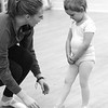 Teacher Abby Tanger works with Aubrey Salter during dance class.