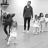Cindy Conley and Abby Tanger work on toe points and balance with the students.