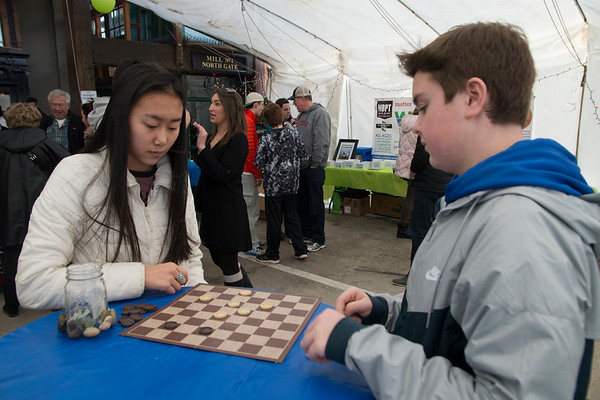JIM VAIKNORAS/Staff photo Olivia Sousa, 16, and Trevor Cody, 15, play checkers at the WE=NBPT Winter Festival at the Tannery in Newburyport.