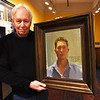 BRYAN EATON/Staff photo. Jurney holds a portrait of Martin Dimitrov, from Chandler, Arizona. He was the first winner, last year, of the Donald and Kim Jurney Traveling Fellowship.