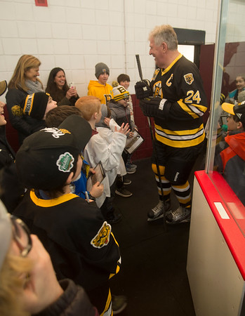 JIM VAIKNORAS/Staff photo Bruin's great Terry O'Reilly, talks with fans before Newburyport Youth Hockey's game against the Boston Bruin's Alumni team Saturday at the Graf Rink in Newburyport.