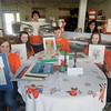 Amesbury: Teen leader hold artwork for Saturday's fundraiser for Lucy's Love Bus, a fund created after the death of 12-year-old Lucy Grogan of cancer.  Infront from the left are Ali Pelletier, Jane Grogan, Jackson Harris, Katy O'Neill and Signe Frick, back Jason Grissino, Evan Grissino, Isabel Prussman and Caroline Logan. JIm Vaiknoras/staff photo June 2011