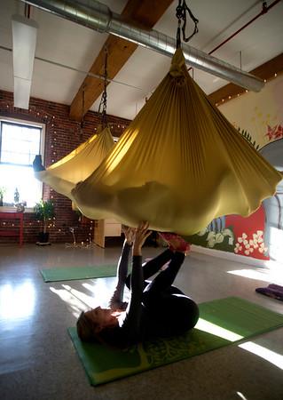 JIM VAIKNORAS/Staff photo Yoga instructor Carrie Schumacher works with  Irene Sullivan at the Sajni Center in Amesbury.