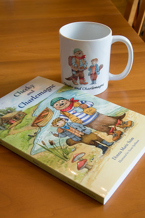 "JIM VAIKNORAS/staff photo  ""Cheeky and Charlemange"" and a mug with their likeness."