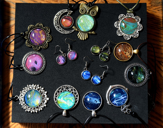 JIM VAIKNORAS/Staff photo Jewelry made from dripped paint left over from art work made by Artist Melissa Wilkinson.