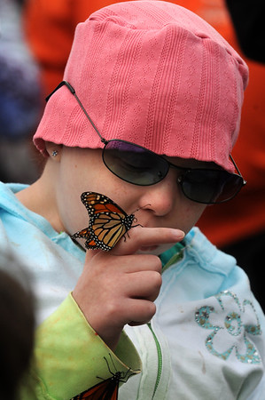 Amesbury:A butterfly rests on Kate O'Neill's finger at the Fly-Away Festival at Woodsom Farm Sunday. Kate was in the hospital with Lucy Grogan, who died of cancer in 2006 and inspired the event. Jim Vaiknoras/Staff photo Amesbury:A butterfly rests on Kate O'Neill's finger at the Fly-Away Festival at Woodsom Farm Sunday. Kate was in the hospital with Lucy Grogan, who died of cancer in 2006 and inspired the event. Jim Vaiknoras/Staff photo Sept 2010