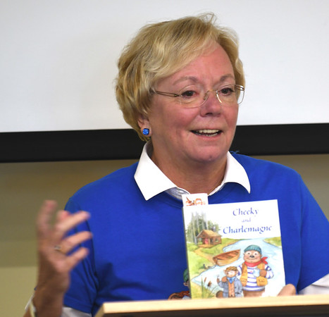 "JIM VAIKNORAS/staff photo Author Donna Seim reads from her book ""Cheeky and Charlemange"" at a reception at the Joppa Flats Education Center."