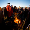 JIM VAIKNORAS/Staff photo People warm up around small fires at the Old Newbury Christmas Tree Bonfire at the Tendercrop Farm fields and Spencer Perce-Little Farm in Newbury Saturday night.