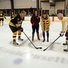 JIM VAIKNORAS/Staff photo Bruin's great Terry O'Reilly, Newburyport Youth Hockey's Keri Sullivan, Newburyport Police Officer Megan Tierney, and Clipper's Captain Dick Teirney at ceremonial puck drop before their game Saturday at the Graf Rink in Newburyport.