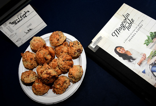 JIM VAIKNORAS/Staff photo Bacon and Gruyere Biscuits by Lee Logan of Newbury with this months cook book Magnolia Table at the Newburyport Library.