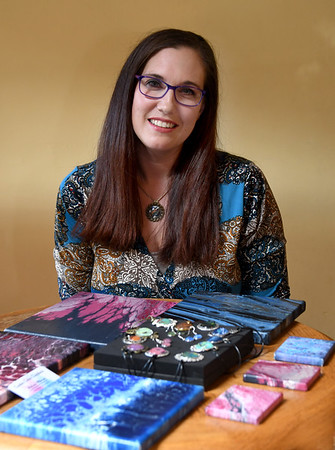 JIM VAIKNORAS/Staff photo Artist Melissa Wilkinson poses with some of her pieces.