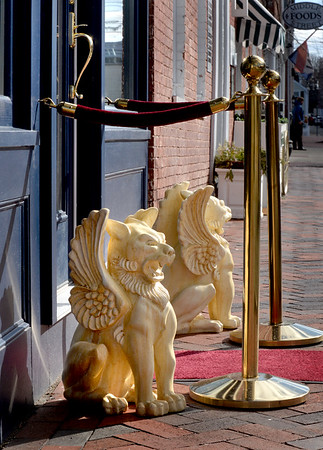 BRYAN EATON/Staff Photo. Gryphons and a red carpet greet shoppers as they enter Edit on Middle Street in Newburyport.