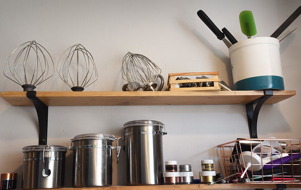 BRYAN EATON/Staff Photo. Tools of the cookie making trade line the shelves in Renee Terry's kitchen.