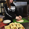 BRYAN EATON/Staff Photo. Kaliah Chernick, 13, of Plum Island became an expert in making wraps as she perfected roast beef, herbed cheese and vegetable ones in cooking class at the Boys and Girls Club in Salisbury. The theme in that particulat week's class was lunch where members also made chicken noodle soup, macaroni and cheese, chicken quesadillas and lemon squares.
