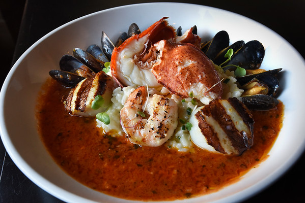 BRYAN EATON/Staff Photo. The Seafood Risotto contains half a lobster, shrimp, scallops and mussels.