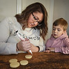 BRYAN EATON/Staff Photo. Bryson, 4, is not shy about giving advice to mom when she's decorating her cookies.