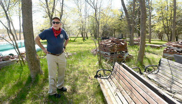 "BRYAN EATON/Staff photo. Newburyport history enthusiast Jack Santos looks around a bluff behind the Newburyport DPS yard searching for evidence of a ""pest house"" he thinks was in that location."