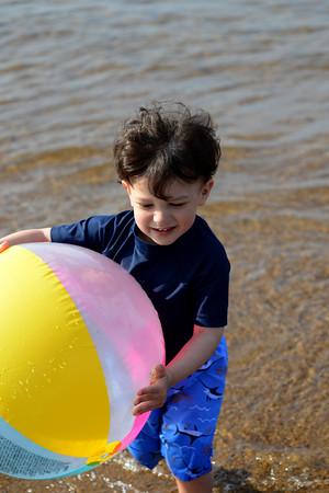 Jonathan Hosein wearing iPlay SPF swimshirt and iPlay swim trunks