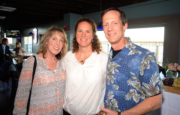 JIM VAIKNORAS/Staff photo Nancy Kaplan-Corbett, Sally Milliken and Jim Dooling at the Merrohawke fundraiser auction at Michael's Harborside.