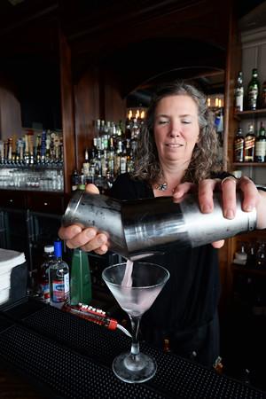 "Black Cow bartender Lori Bayley makes her concoction ""Even Keel"" which is Keel Vodka, Tyku Citrus Liqueur, Cranberry Juice & Muddled Grapefruit & Mint. BRYAN EATON/Staff Photo."