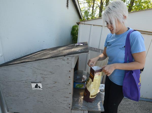JIM VAIKNORAS/Staff photo  Jamie Viator fills a feeding station at the Merrimack River Rescue Society in Salisbury.