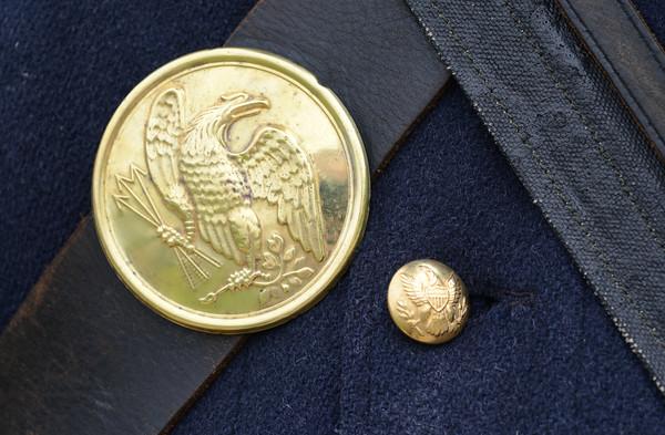 JIM VAIKNORAS/Staff photo Bill Hallet's brass buttons on his wool uniform