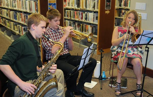JIM VAIKNORAS/Staff photo <br /> Newburyport High School students Andrew Alman, Devon Johnson and Kaylee Hawks perform at Books in Bloom at the Newburyport Public Library.