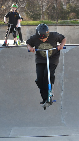JIM VAIKNORAS/Staff photo Andrew Balkus, 10, of Newbury catches some air on his razor scooter at the Newburyport Skate Park.