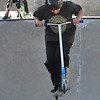 JIM VAIKNORAS/Staff photo Andrew Balkus, 10, of Newbury catches some air on his razor scooter at the Newburyport Skate Park.