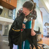 JIM VAIKNORAS/Staff photo Lucy gives registered nurse Michelle Petryk, a kiss in the Anna Jaques Cancer Center at the Anna Jaques Hospital.